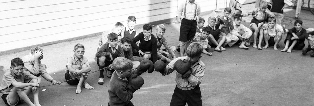black and white photo, school children boxing